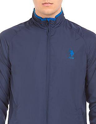 USPA Active Solid Raglan Sleeve Shell Jacket